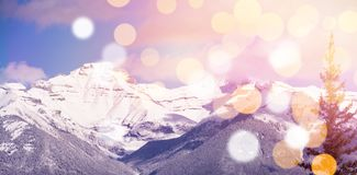 Snowcapped mountains with bokeh in foreground. Scenic view of snowcapped mountains with bokeh in foreground Royalty Free Stock Image