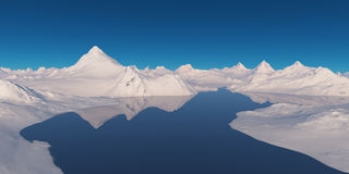 Snowcapped mountains surrounded by water. Royalty Free Stock Photo