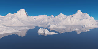 Snowcapped mountains surrounded by water. Royalty Free Stock Images