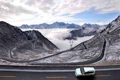 Between snowcapped mountains of Tibet highway Stock Image
