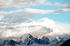 Snowcapped mountains under the blue sky Royalty Free Stock Photo