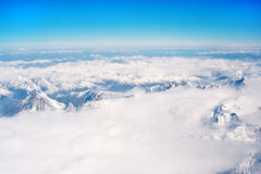 Snowcapped mountains under the blue sky Royalty Free Stock Images