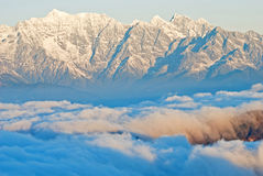 Snowcapped mountains under the blue sky Stock Photography