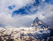 Snowcapped summit top of mountain in Himalayas. In clouds. Himachal Pradesh, India Royalty Free Stock Photography