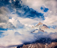 Snowcapped summit top of mountain in Himalayas. In clouds. Himachal Pradesh, India Stock Image