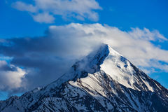 Snowcapped top of mountain in Himalayas Royalty Free Stock Images