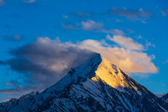 Snowcapped top of mountain in Himalayas Stock Photo