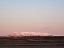 Snowcapped volcano Stock Photo
