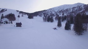 Snowcat aerial. A snow covered mountain aerial footage stock footage