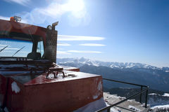 Snowcat on the backdrop of a beautiful panorama Royalty Free Stock Photos