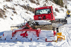 Snowcat on the edge of the track Stock Images