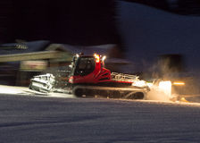 Snowcat. In low light evening Stock Image