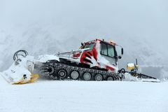 Snowcat, machine for snow removal Stock Photos