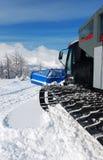 Snowcat in montagne Immagini Stock