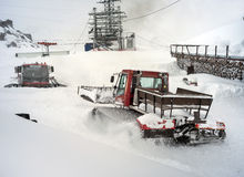 Snowcat in motion in mountains Stock Photos