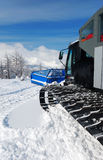Snowcat in mountains Stock Images