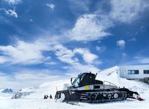 Snowcat in mountains Royalty Free Stock Photography
