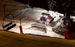 Snowcat night. Two night snowcat standing on the ski slopes and the chair lift silhouette Royalty Free Stock Photo