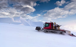Snowcat with people Stock Images