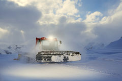 Snowcat rides to work in the evening Royalty Free Stock Photos