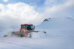 Snowcat rides to work in the evening Royalty Free Stock Images