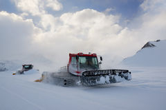 Snowcat rides to work in the evening Royalty Free Stock Photography
