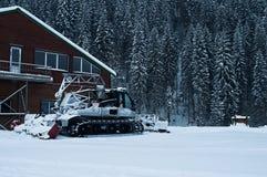 Snowcat on ski resort. In snowy weather Royalty Free Stock Photo