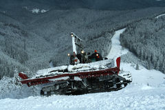 Snowcat on ski slopes Stock Images