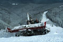 Snowcat on ski slopes Stock Images