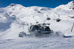 Snowcat and skilift in alps Stock Images