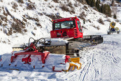 Snowcat and snow gun Royalty Free Stock Images