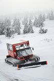 Snowcat in snowy country Stock Photos