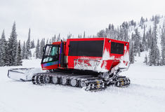 Snowcat in the snowy mountains Stock Photography