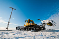 Snowcat on top of the mountain Stock Photography