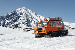 Snowcat transportation sportsman on snowy slopes of volcano Royalty Free Stock Image