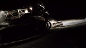 Snowcat work in the night stock video