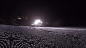 Snowcat work in the night stock video footage