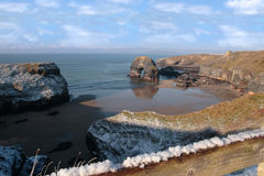 Snowcovered coast beach and virgin rock Stock Photo