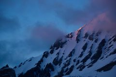 Snowcovered peak in red light Stock Photo
