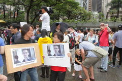Snowden Gains Support From Protesters in Hong Kong. Several hundred demonstrators took to Hong Kongs streets in the rain Saturday voicing support for ex-CIA Royalty Free Stock Photo