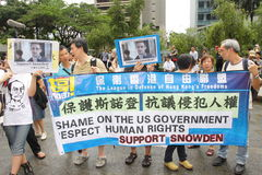 Snowden Gains Support From Protesters in Hong Kong. Several hundred demonstrators took to Hong Kongs streets in the rain Saturday voicing support for ex-CIA Royalty Free Stock Images