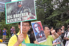 Snowden Gains Support From Protesters in Hong Kong. Several hundred demonstrators took to Hong Kongs streets in the rain Saturday voicing support for ex-CIA Royalty Free Stock Image