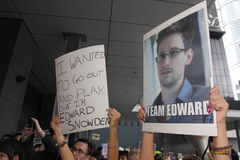 Snowden Gains Support From Protesters in Hong Kong. Several hundred demonstrators took to Hong Kongs streets in the rain Saturday voicing support for ex-CIA Stock Image