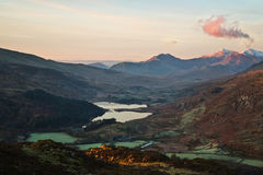 Snowdon dawn. Snowdon (Welsh: Yr Wyddfa, pronounced [əɾ ˈwɨ̞ðva]) is the highest mountain in Wales, at an elevation of 1,085 metres (3,560 ft) above sea Royalty Free Stock Image