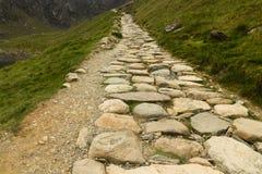 Snowdon stone flagged path up to peak of Snowdon Miners track. Flagged path Miners track to summit of Snowdon. Snowdonia, Wales, United Kingdom stock image