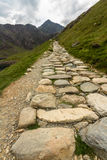 Snowdon stone flagged path up to peak of Snowdon Miners track. Flagged path Miners track to summit of Snowdon. Snowdonia, Wales, United Kingdom royalty free stock image