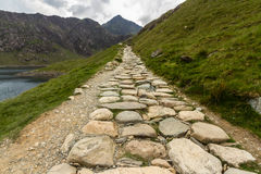 Snowdon stone flagged path up to peak of Snowdon Miners track. Flagged path Miners track to summit of Snowdon. Snowdonia, Wales, United Kingdom royalty free stock photography