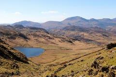 Snowdonia North Wales mountains lake. Mountains Snowdonia North Wales rocks landscape Stock Images