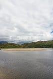 Snowdonia, River Dwyryd, sandbank, rocky hills and trees. Stock Photography