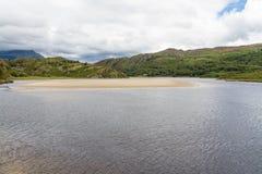 Snowdonia, River Dwyryd, sandbank, rocky hills and trees. Royalty Free Stock Images
